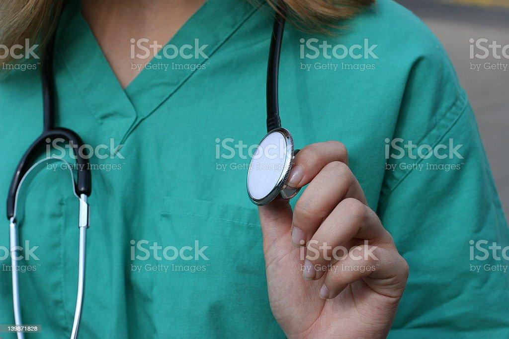 Nurse holding stethoscope. royalty-free stock photo