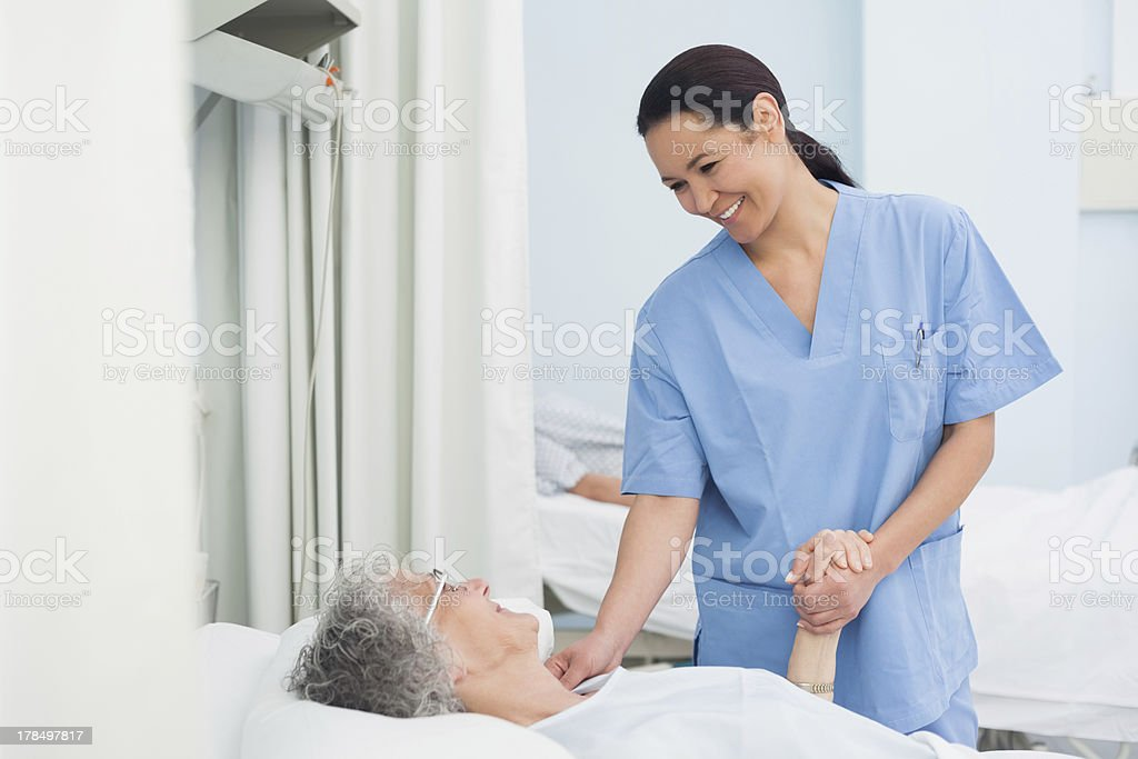 Nurse holding the hand of a patient royalty-free stock photo