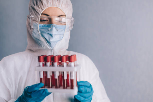A nurse holds blood samples. stock photo
