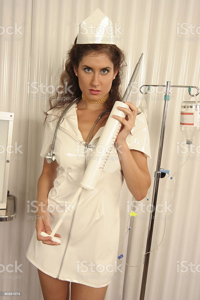 nurse holds up syringe stock photo