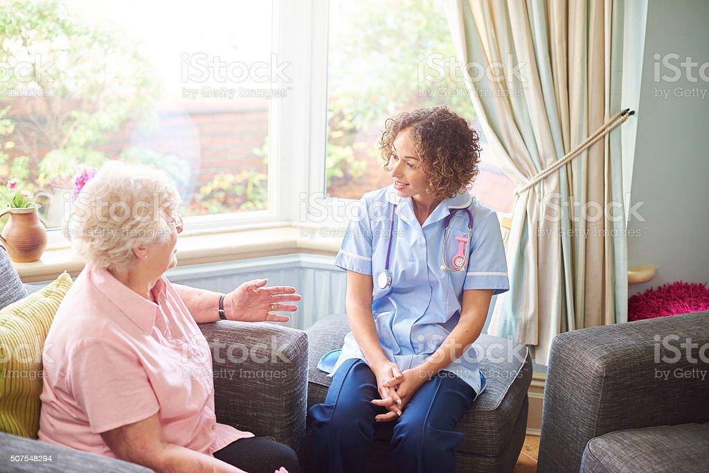 nurse house call for senior patient stock photo