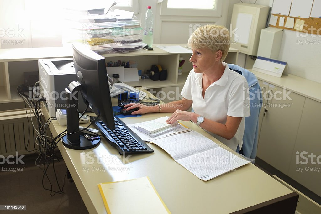 Nurse in her office,working with computer royalty-free stock photo