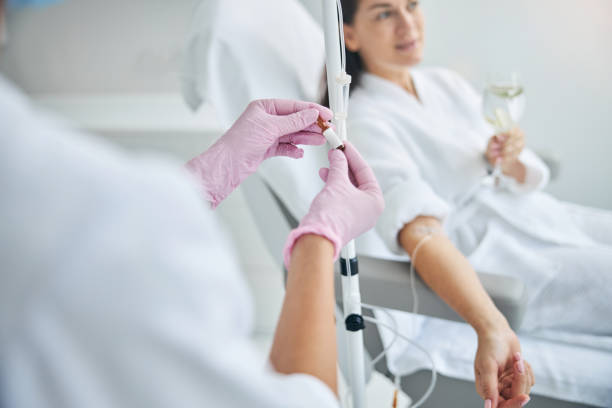 Nurse in latex gloves performing a medical procedure stock photo