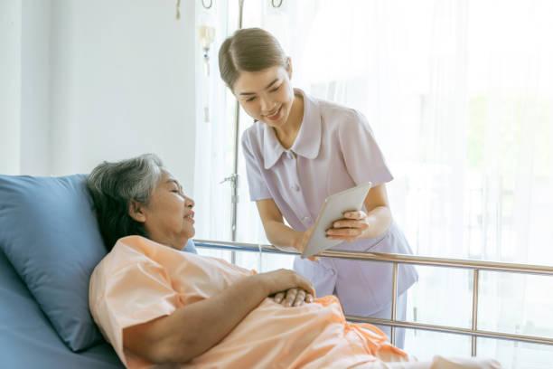 nurse Inform health examination results to encourage senior elderly woman patients in the hospital- medical senior concept stock photo