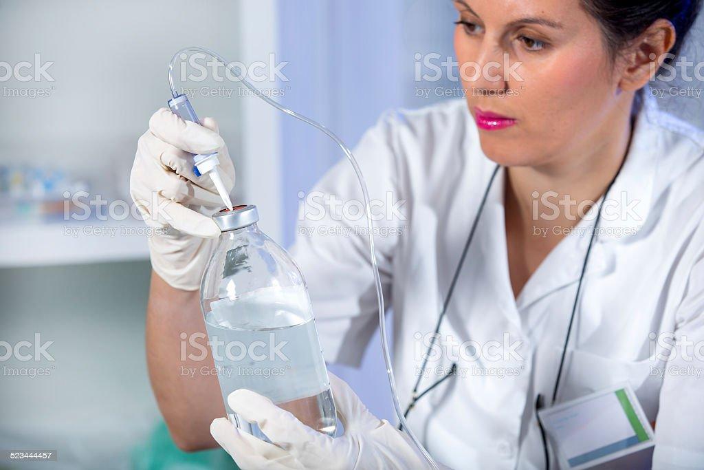 Nurse is preparing an infusion stock photo