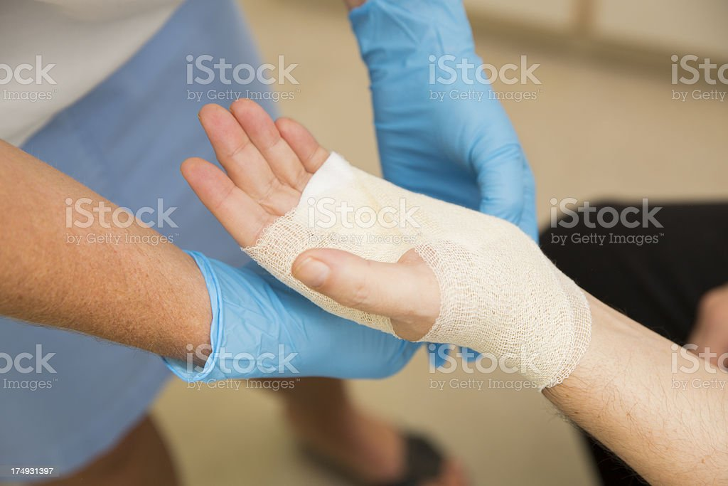 Nurse is treating patient after carpal tunnel syndrome operation royalty-free stock photo