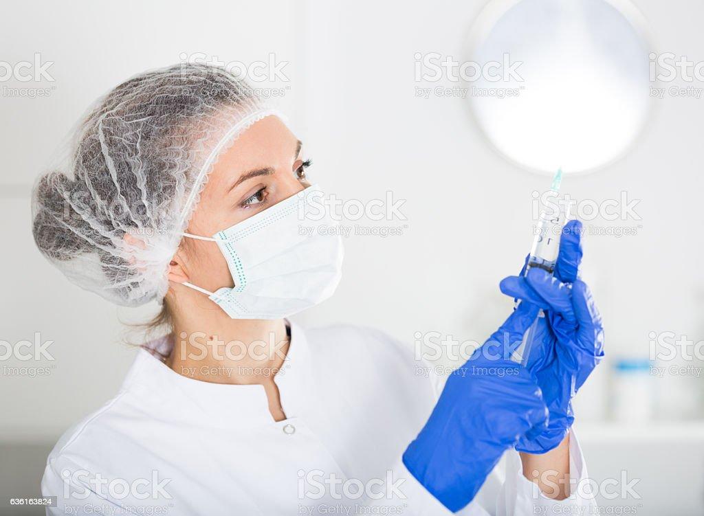 Nurse making injection stock photo