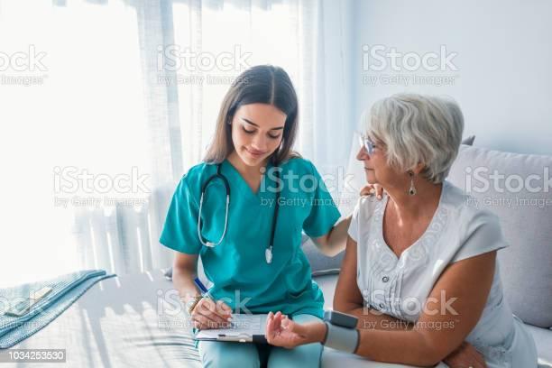 Nurse measuring blood pressure of senior woman at home picture id1034253530?b=1&k=6&m=1034253530&s=612x612&h=crpimojfn37m7lhvkkpzdoru3iy59xvetfw0 sg33w4=