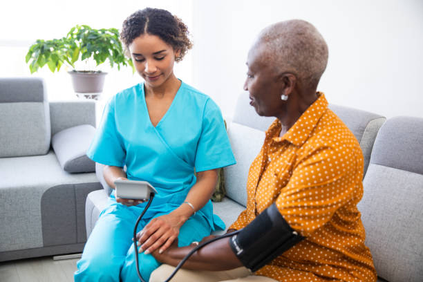 Nurse Measuring Patient's Blood Pressure stock photo