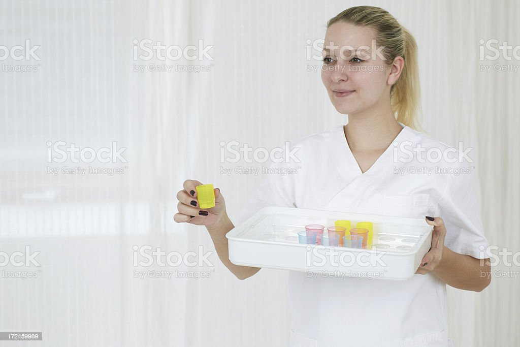 Nurse offering pills royalty-free stock photo