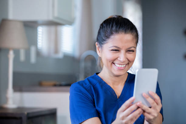 Nurse or doctor video chatting with patient during appointment while working from home stock photo
