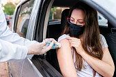 istock Nurse performing drive-thru immunization 1279242030