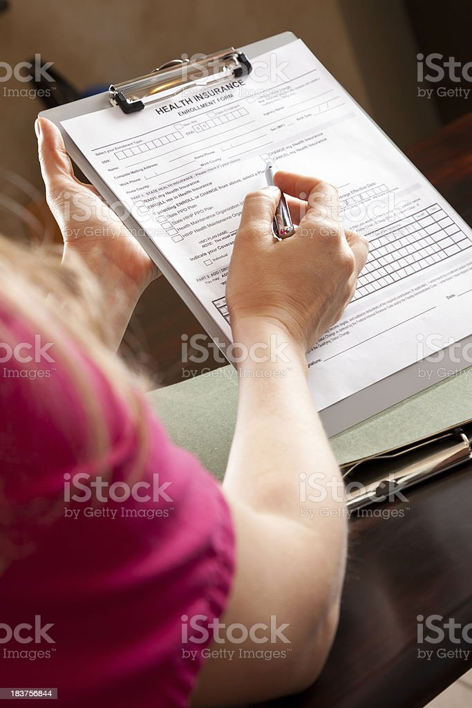 Nurse Pointing On Medical Health Insurance Form royalty-free stock photo