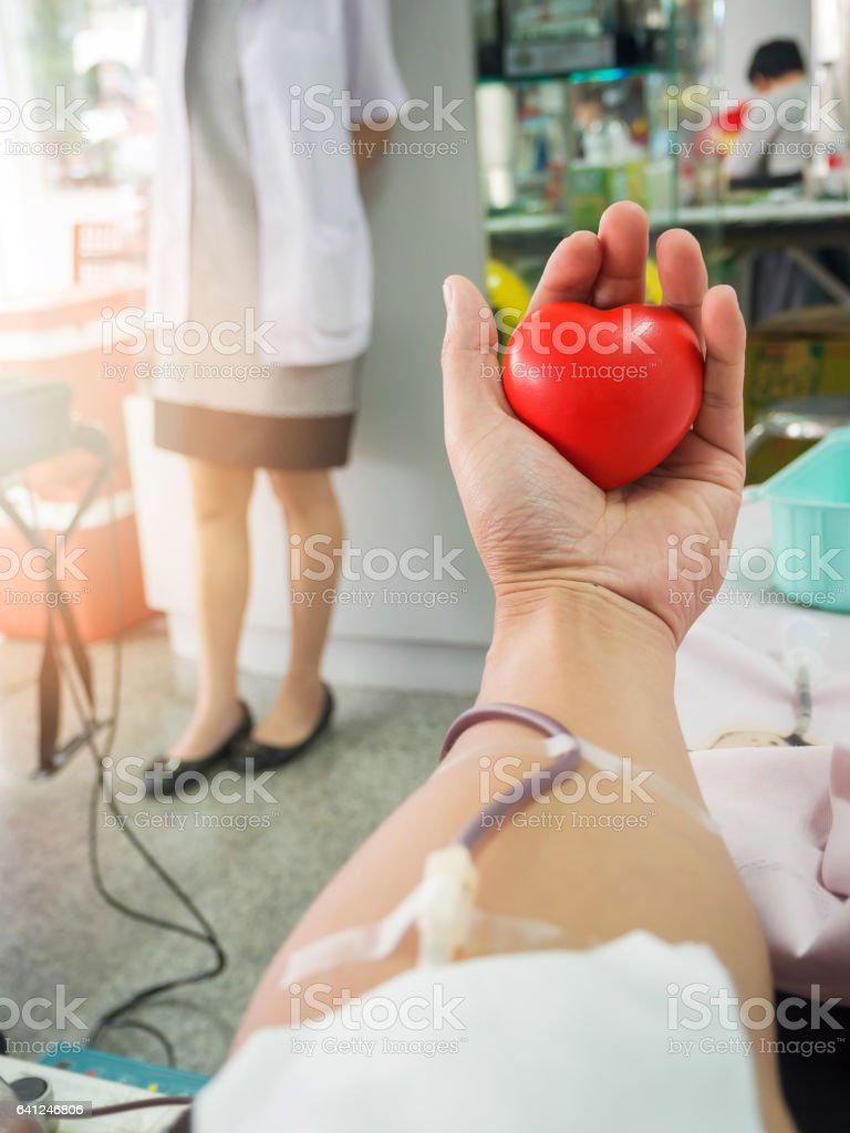 Nurse receiving blood from blood donor in hospital. stock photo