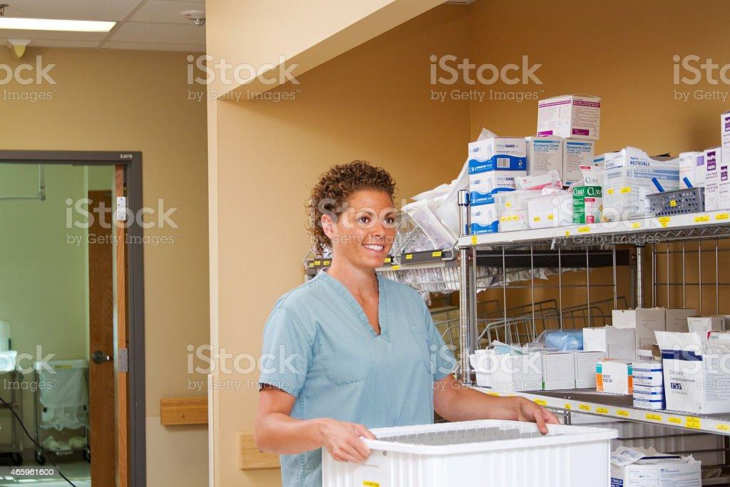 Nurse retrieving supplies stock photo