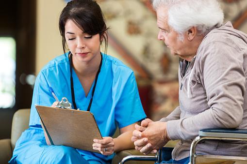 istock Nurse reveiws patient information with senior man 517850898
