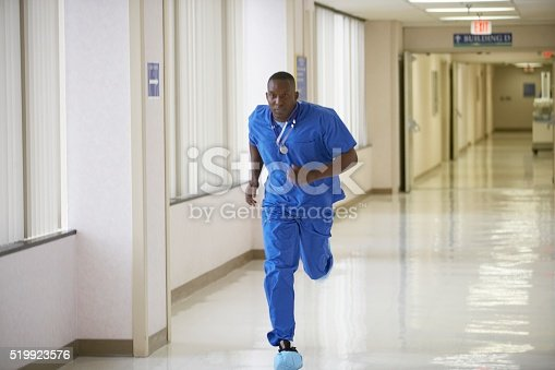 Nurse running through a hospital corridor