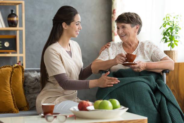 Nurse serving coffee to senior picture id844452026?b=1&k=6&m=844452026&s=612x612&w=0&h=sn m5elrjhq23egsyn63pifznwuweypkslzdxhxeaiw=