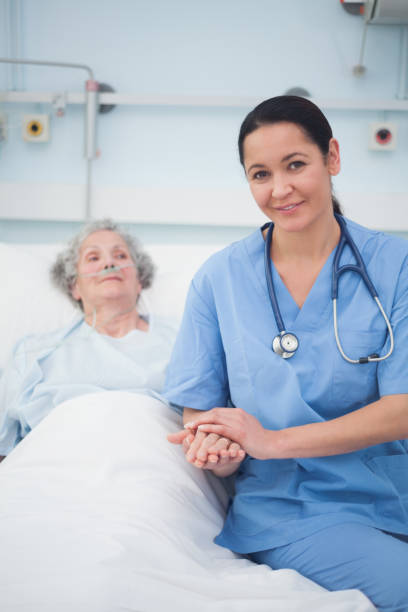 Nurse sitting on the bed next to a patient picture id847621048?b=1&k=6&m=847621048&s=612x612&w=0&h=cnw9 cqkacaxke idkrqxus4i wkmpvz5 4 0mssiwe=