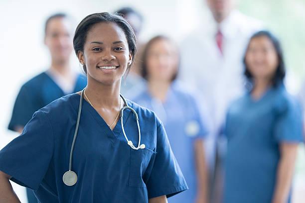 Nurse Smiling at Work stock photo