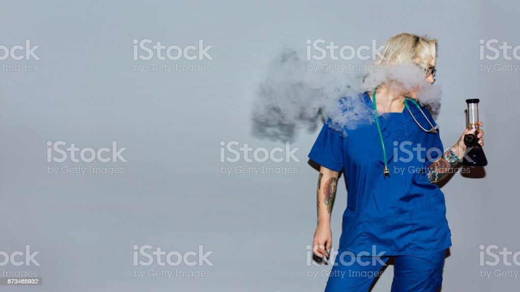 Nurse smoking medical marijuana stock photo