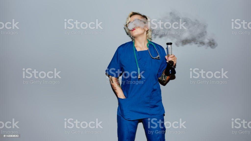Nurse smoking pot stock photo