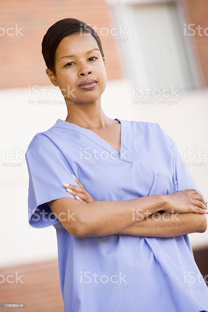 Nurse Standing Outside A Hospital royalty-free stock photo