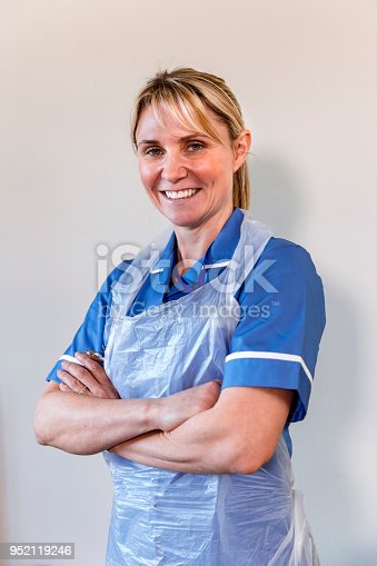 istock Nurse Standing with her Arms Folded 952119246