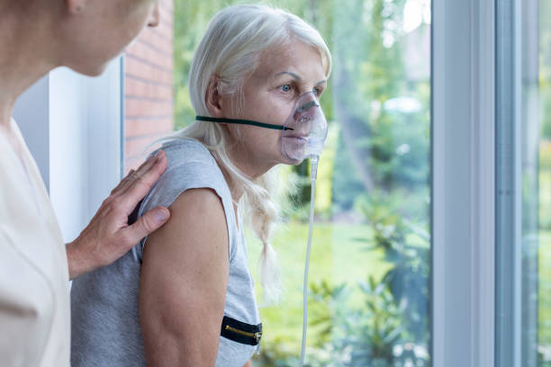 Nurse supporting sick senior woman with oxygen mask in the hospital Nurse supporting sick senior woman with oxygen mask in the hospital oxygen stock pictures, royalty-free photos & images