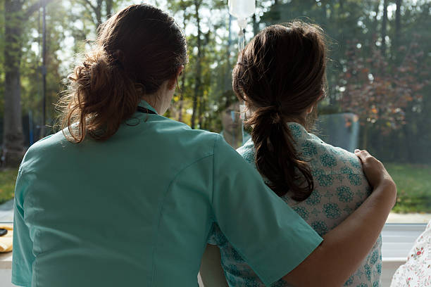 nurse take care of sad patient - inpatient stock pictures, royalty-free photos & images