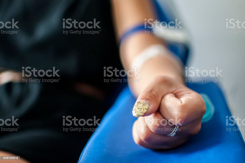 A nurse takes blood sample for medical examination stock photo