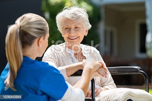 istock Nurse takes care of old patient 1029340354