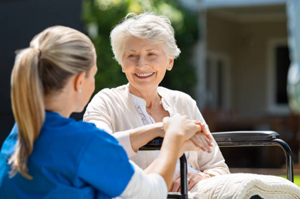 nurse takes care of old patient - geriatrics stock pictures, royalty-free photos & images