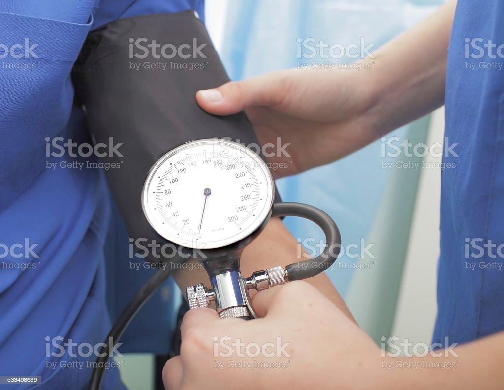 Nurse taking a blood pressure stock photo