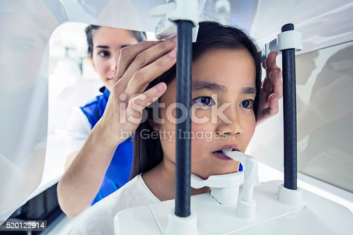 183306794istockphoto Nurse taking a CAT scan to a child 520122914