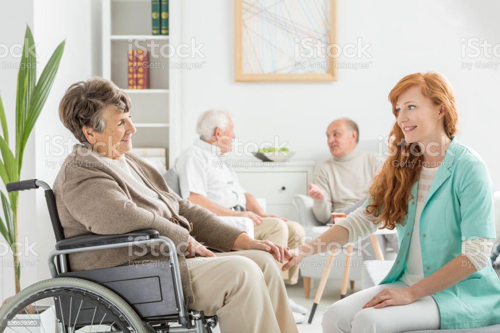 Nurse talking to lady stock photo