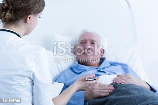 istock Nurse talking to patient 604356798