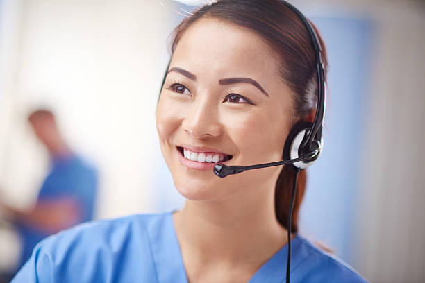 nurse telephonist - nurse on phone stock photos and pictures