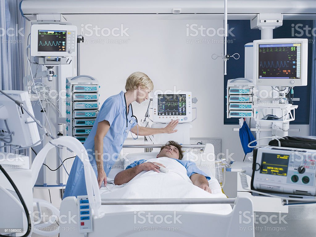Nurse tending patient in intensive care royalty-free stock photo