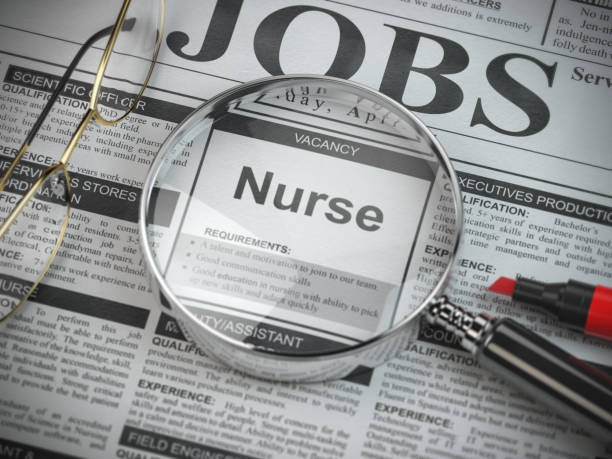 Nurse vacancy in the ad of job search newspaper with loupe. stock photo
