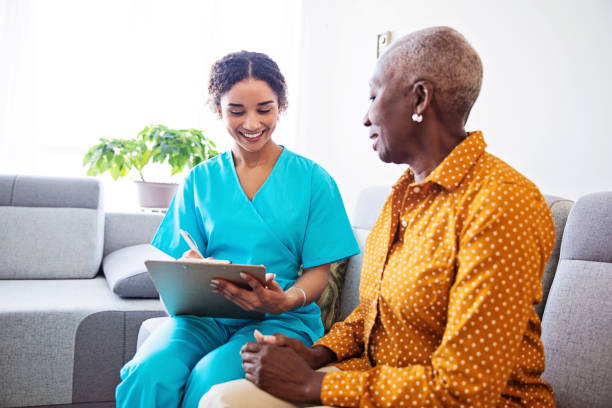 Nurse Visiting a Senior Female Patient at Home stock photo