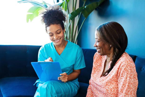 Nurse Visiting a Senior Patient stock photo