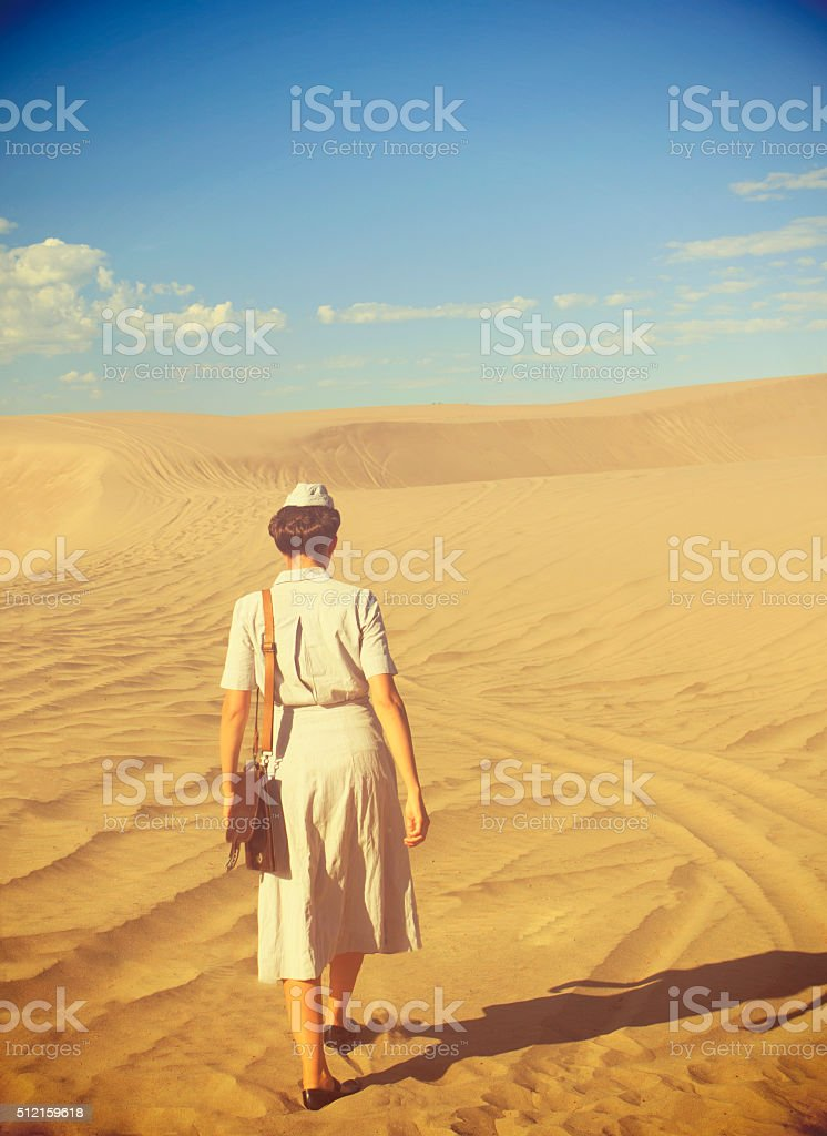 WWII Nurse Walking Away From The Camera In The Desert stock photo