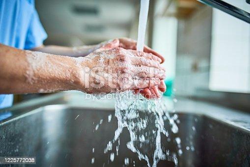 istock Nurse washing hands to avoid covid 19 1225772038
