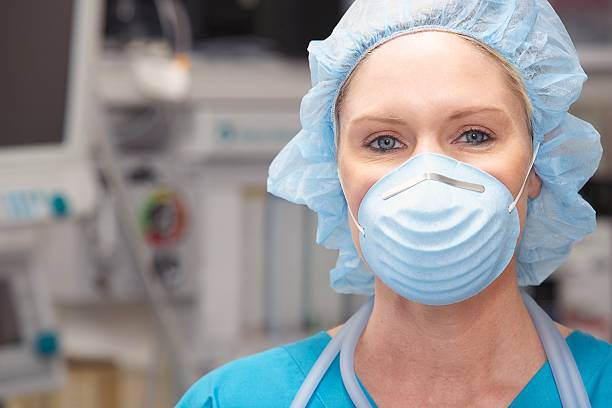 Nurse wearing a face mask stock photo