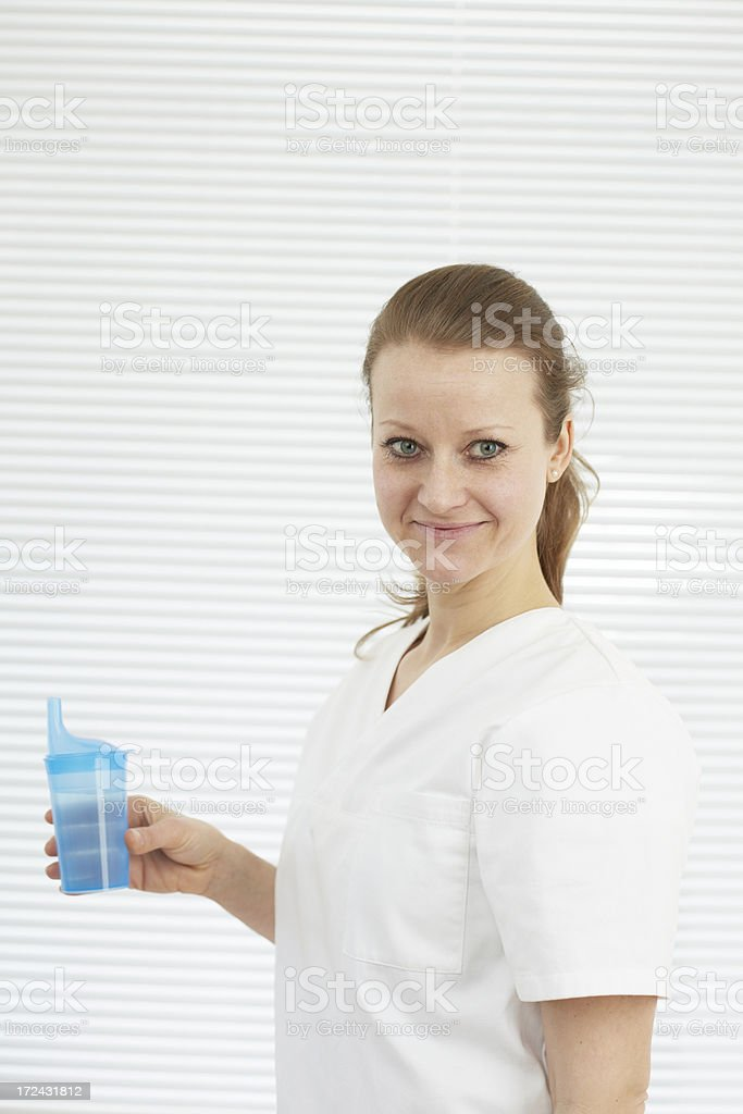 Nurse with a feeding cup royalty-free stock photo