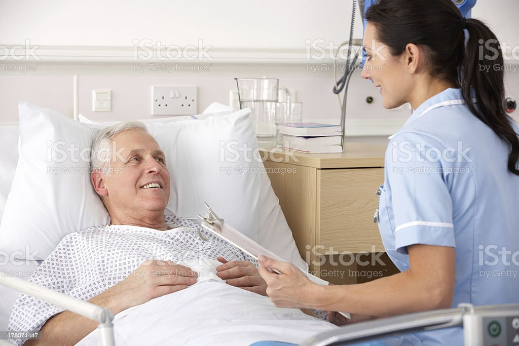 Nurse with male patient in UK Accident and Emergency stock photo