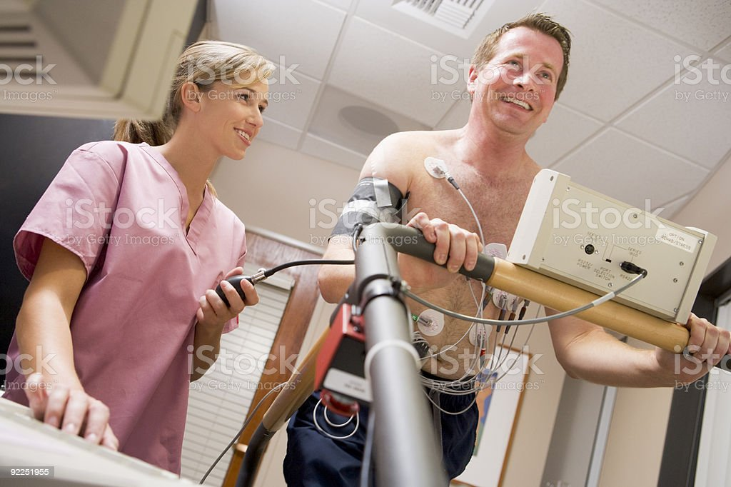 Nurse With Patient During Health Check royalty-free stock photo