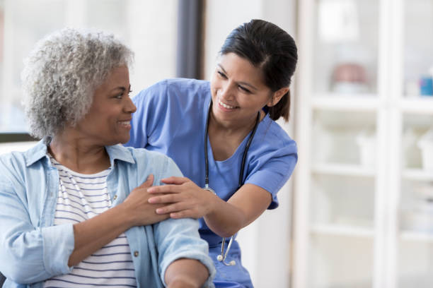 nurse with senior patient - geriatrics stock pictures, royalty-free photos & images
