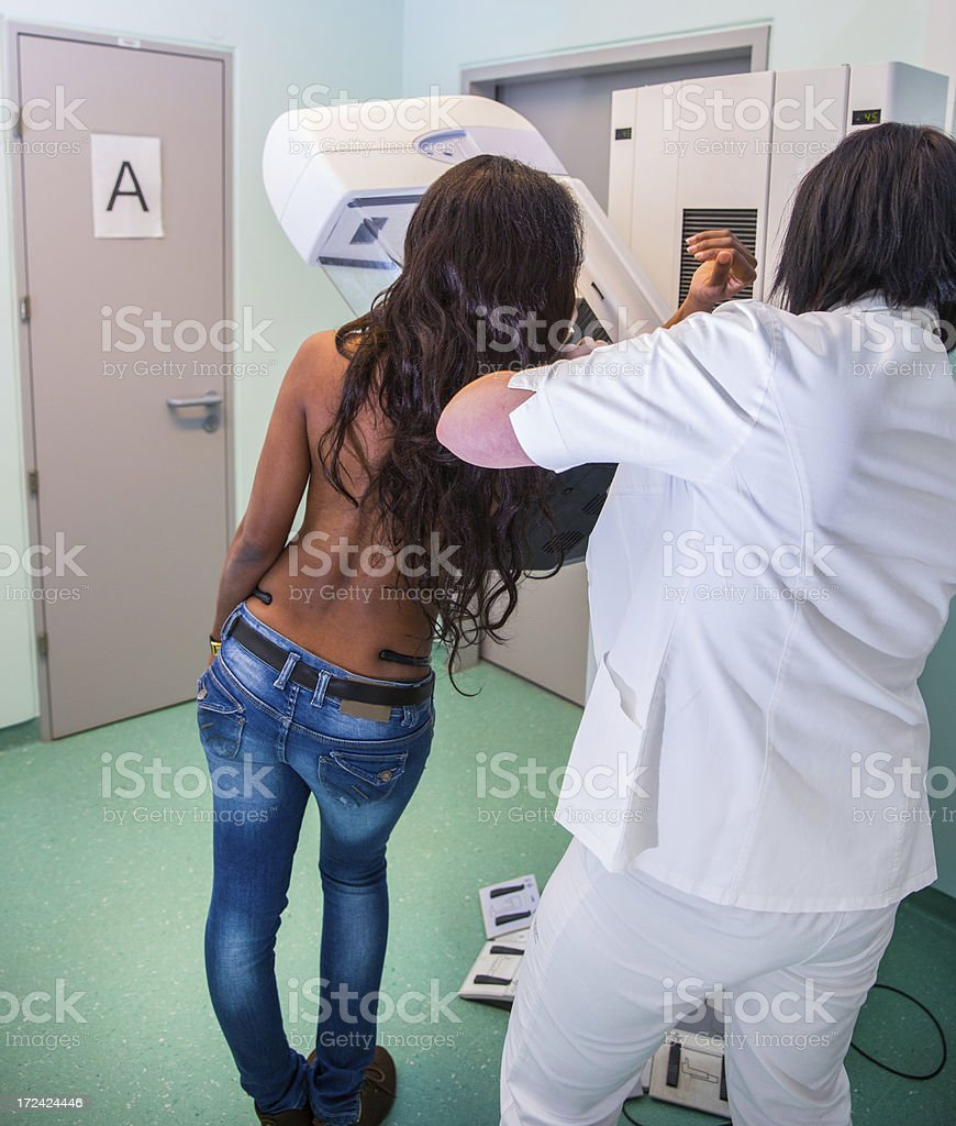 Nurse with young  black women having a mammography stock photo